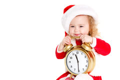 Girl dressed as Santa with a big clock Stock Photography