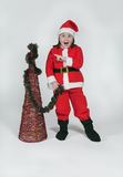 Girl dressed as Santa Claus with Christmas Stock Image