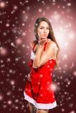 girl dressed as Santa Claus on Christmas background Stock Photos