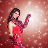 Girl dressed as Santa Claus on Christmas background Stock Photos