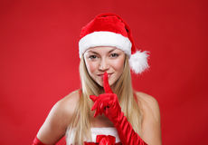 Girl dressed as Santa Claus on a red background. Young girl dressed as Santa Claus on a red background Stock Photography