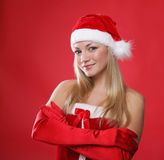 Girl dressed as Santa Claus on a red background Royalty Free Stock Images