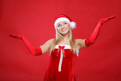 Girl dressed as Santa Claus on a red background Stock Photo