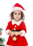 Girl dressed as Santa Claus with a toy in the Royalty Free Stock Photo