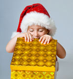 Girl dressed as Santa with gifts Royalty Free Stock Photography