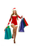 Girl dressed as Santa with many shopping bags Royalty Free Stock Image