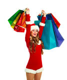 Girl dressed as Santa with many shopping bags Stock Photo