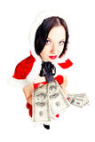 Girl dressed as Santa with money Royalty Free Stock Photography