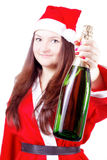 girl dressed as Santa offers champagne Royalty Free Stock Image