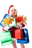 Girl dressed as Santa with presents. Girl dressed as Santa with a lot of Christmas presents Royalty Free Stock Photography