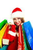 Girl dressed as Santa with shopping bags Royalty Free Stock Image