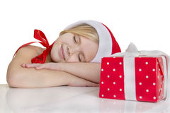 Girl dressed as Santa sleeps Stock Photos