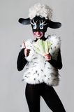 A girl dressed as a sheep. The unusual costume and body painting Stock Photo