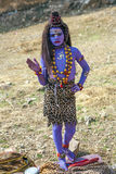 Girl dressed as Shiwa begs for Royalty Free Stock Image