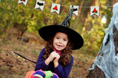 Girl dressed as a witch for Halloween. Little girl dressed as a witch for Halloween Royalty Free Stock Image
