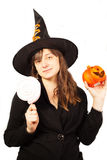 Girl dressed as a witch on a white background Stock Photos