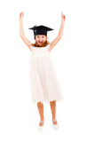 Girl dressed Bachelor cap jumping Stock Photo