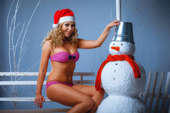 Girl dressed in bikini and santa hat Royalty Free Stock Image