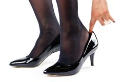 The girl is dressed in black shoes. Close up. Isolated on a whit Stock Photography