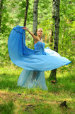 Girl dressed in blue dress Stock Images