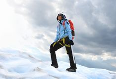 The girl standing on the icy top of glacier Royalty Free Stock Images