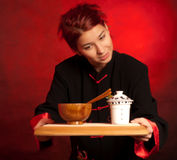 Girl dressed in chinese clothes serving tea Royalty Free Stock Photography