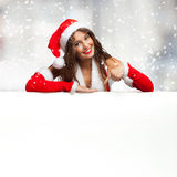Girl dressed for Christmas showing a blank board Stock Photography