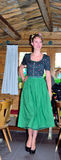 Girl dressed in clothes typical tyrolean Stock Images