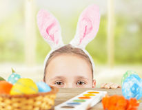 Girl dressed in Easter bunny ears on a holiday Stock Images