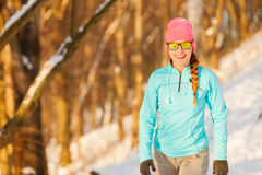 Girl dressed for exercising in winter Stock Images