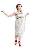 Girl dressed in greek costume dancing on white Royalty Free Stock Image