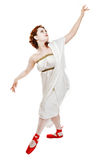 Girl dressed in greek costume dancing on white Royalty Free Stock Photos