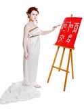 Girl dressed in greek costume painting on white Royalty Free Stock Photos