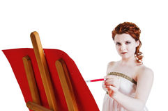 Girl dressed in greek costume painting on white Stock Image