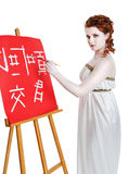 Girl dressed in greek costume painting on white Royalty Free Stock Photo