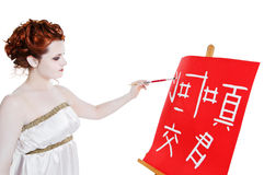 Girl dressed in greek costume painting on white Royalty Free Stock Photography