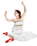 Girl dressed in greek costume sitting on white Stock Image