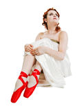 Girl dressed in greek costume sitting on white Royalty Free Stock Photo