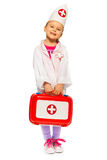 Girl dressed like a doctor with toy first-aid kit Stock Image