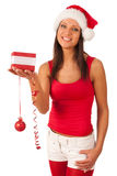 Girl dressed like Santa with Christmas present Royalty Free Stock Images