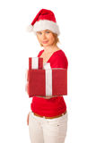 Girl dressed like Santa with Christmas presents Royalty Free Stock Image
