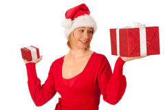 Girl dressed like Santa with Christmas presents Royalty Free Stock Photography