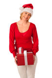 Girl dressed like Santa with Christmas presents Stock Photos