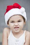 The girl dressed like a santa claus. Asian emotional little girl dressed like a santa claus Stock Photos
