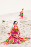 Girl dressed in a Mexican outfit and playing Stock Image