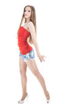 Girl dressed in a red dance. Girl with long hair wearing a red dance isolated on the white Stock Photography