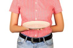 Girl dressed in a red shirt is holding a white empty plate for your dish. perspective view Template for your design. isolated on w royalty free stock photography