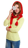Girl dressed red woolen cap and scarf show big snowflake, posing in studio on white background Stock Photo