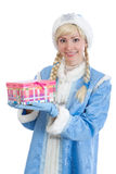 Girl dressed in russian christmas costume. Smiling girl dressed in traditional russian christmas costume of Snegurochka (Snow Maiden) with present box, isolated royalty free stock image
