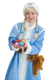 Girl dressed in russian christmas costume. Smiling girl dressed in traditional russian christmas costume of Snegurochka (Snow Maiden) with gold tinsel and stock photography